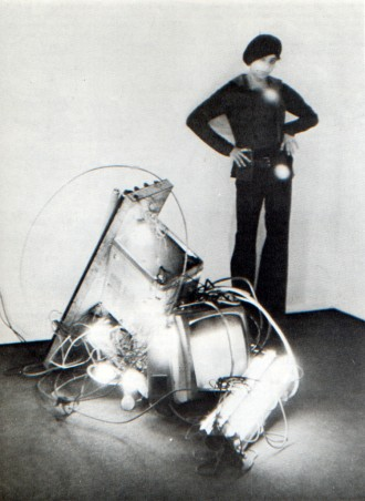 01 Alan Vega with his sculpture of TVs and other electrical appliances gathered from the trash, 1975