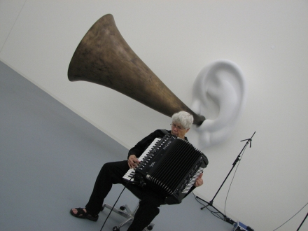 "01 Pauline Oliveros performing ""Pauline_s Solo"" with John Baldessari_s Beethoven_s Trumpet (With Ear) Opus # 133 (2007) at Kunstverein Bonn, Germany, 2007. Photograph by Ione"